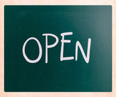 "The word ""Open"" handwritten with white chalk on a blackboard — Stock Photo"