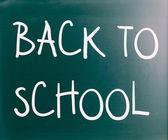 """Back to school"" handwritten with white chalk on a blackboard — Stock Photo"