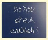 """""""Do you speak english"""" handwritten with white chalk on a blackbo — Stock Photo"""