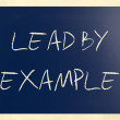 """Lead by example"" handwritten with white chalk on a blackboard — Foto Stock"