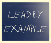 """Lead by example"" handwritten with white chalk on a blackboard — Stockfoto"
