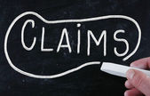 Claims handwritten with chalk on a blackboard — Stock Photo