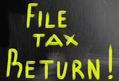 File tax return handwritten with chalk on a blackboard — Stock Photo