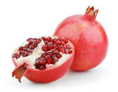 Ripe pomegranate fruits with half — Stock Photo
