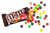 Unwrapped M&M's milk chocolate candies — Stock Photo