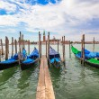 Gondolas moored by Saint Mark squar — Stock Photo