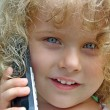 Little girl talk to phone — Stock Photo