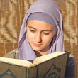 Stock Photo: Beautiful young muslim reading to quran
