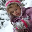 Stock Photo: Beautiful young girl having fun playing in snow