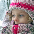 A beautiful young girl having fun playing in the snow — Stock Photo