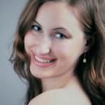 Young woman smiling at camera — Stock Photo #17470395