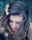 Young woman with flowers in her hair — Stock Photo