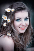 Young woman with flowers in hair — Stock Photo