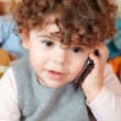 Stock Photo: Baby girl talking on phone