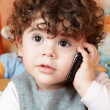 Baby girl talking on phone — Stock Photo