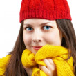 Woman with red hat and yellow scarf — Stockfoto