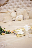 Luxury antique bed with roses — Stock Photo
