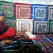Stock Photo: Seller of handmade embroidering products