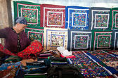 Seller of handmade embroidering products — Stock Photo
