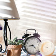 Still life composition with clock — Stock Photo