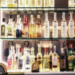 Stock Photo: Alcohol bottles in bar