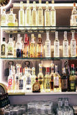 Alcohol bottles in a bar — Stock Photo