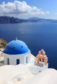 Blue dome and bells at Santorini island in Greece. — Stock Photo
