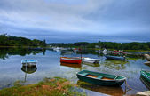Row boats on calm water — Stock Photo