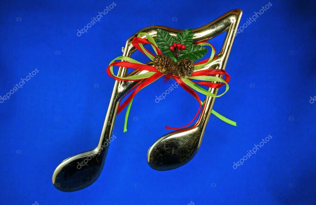 Shinning musical decoration for christmas in gold on a blue background — Stock Photo #13681280