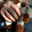Elderly hand with doll 04 - Stock Photo
