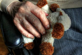 Elderly hand with doll 04 — Stock Photo