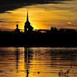 Royalty-Free Stock Photo: Silhouette Nikolo Medvedsky Monastery in sunset light