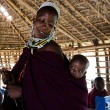 Stock Photo: Masai teacher with baby.