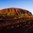 Monolith of Uluru on rising. — Stock Photo #3754789