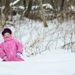 Little girl in winter forest — Stock Photo #49652255