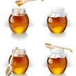 Bank of honey with a wooden spoon — Stock Photo #25629845