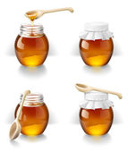 Bank of honey with a wooden spoon — Stock Photo