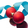Christmas baubles and a blue ribbon — Stock Photo #11283155