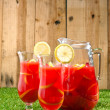 Stock Photo: Chilled Orange Lemon Sangriin summer setting