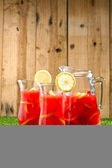 Chilled Orange Lemon Sangria in a summer setting — Stock Photo