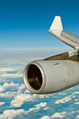 Jet engine of an airplane over the cloudscape — Stock Photo