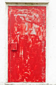 Red colored weathered door — Stock Photo
