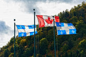 Canadian and the Quebec flag — Stock Photo