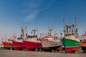 Fish trawler on land — Stock Photo