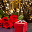 Red present box Champagne and roses — Stock Photo