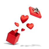Opened gift box with flying hearts — Stockfoto
