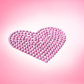 Rhinestones in form of a heart — Stock Photo