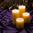 Four candles over purple velvet — Stockfoto #20352883