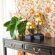 Side table with flowers and interior decoration — Stock Photo #22006653
