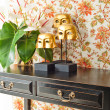 Side table with flowers and interior decoration — Stock Photo #22006709